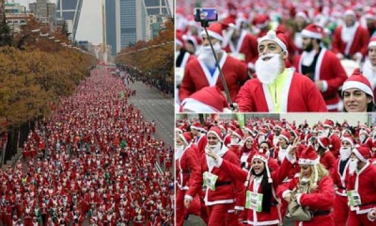 صور: آلاف يشاركون بملابس بابا نويل في سباق ركض بمدريد