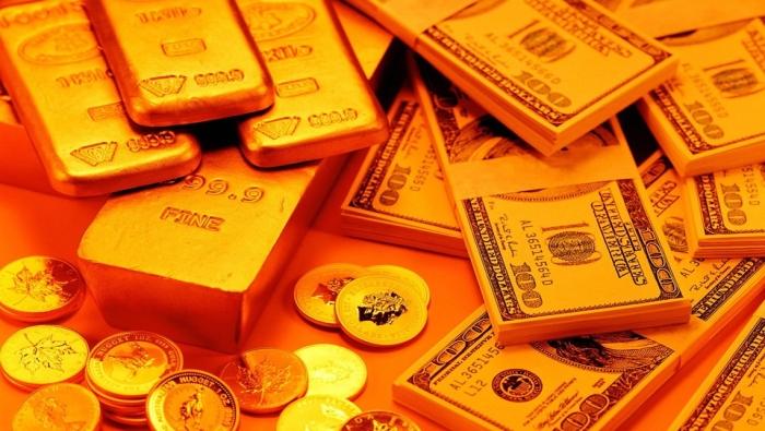 الذهب قرب أدنى مستوى في أسبوعين وقوة الدولار تقلص المكاسب