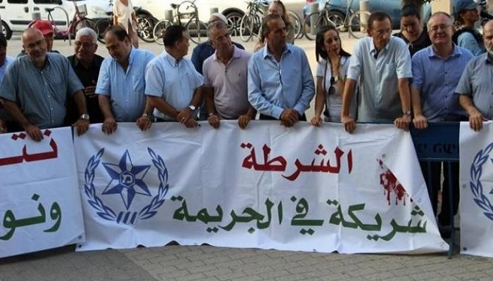 إعلاميو الداخل المحتل يحتجون على تواطؤ شرطة الاحتلال في الجريمة